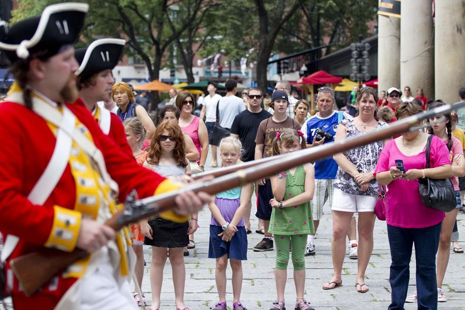 Hold it right there! Tourists watch reenactors perform on the Freedom Trail.